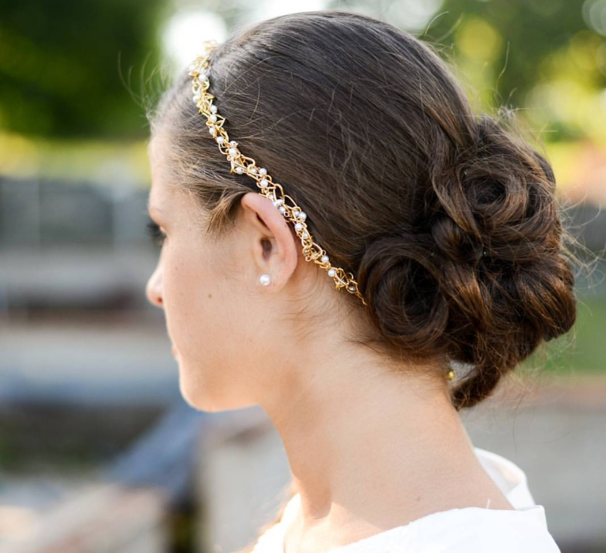 Wedding Hairstyles You'll Love. Classic Low Chignon. Mint Photography. Elegant, Vintage-Style Curls. Tim Waters Photograph. Romantic Updo With a Crown of Roses.